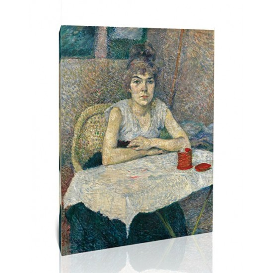 אישה צעירה ליד שולחן